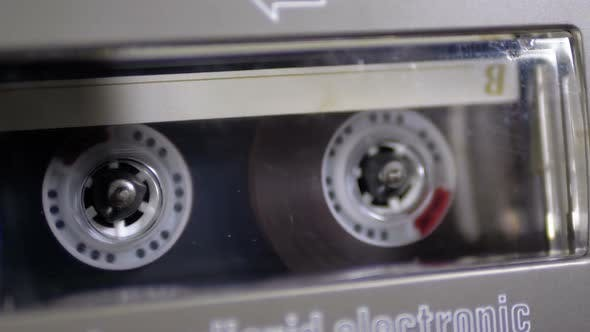 Thumbnail for Audio Cassette Is Inserted Into the Deck of the Audio Tape Recorder Playing and Rotates