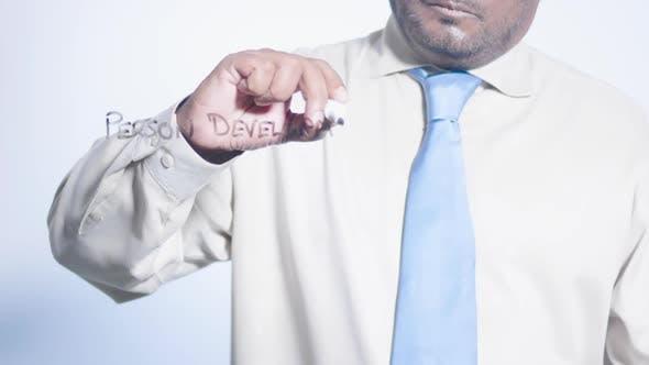 Asian Businessman Writes Personal Development