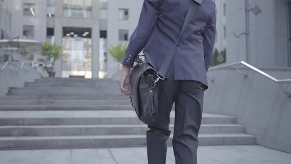 Thumbnail for Cute Little Boy Wearing a Business Suit with Case Walking in the City