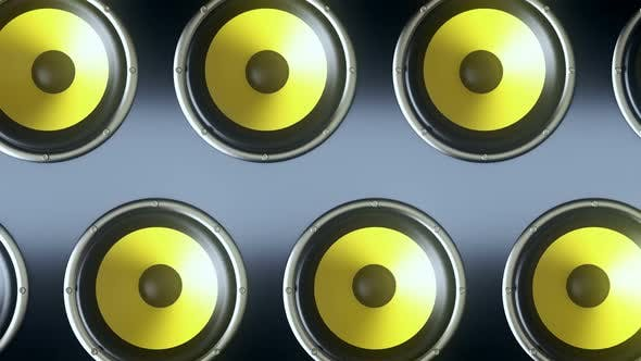 Audio Speakers with Yellow Membranes Playing Rhytmic Music at 90 Bpm Frequency