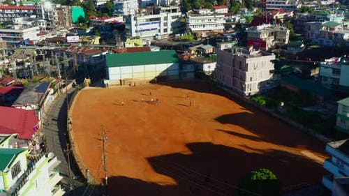 Children play soccer in school yard in Shillong India