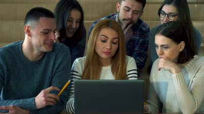 Students Look at Laptop Screen