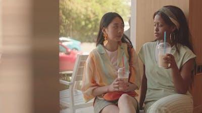 Best Friends Talking in Cafe
