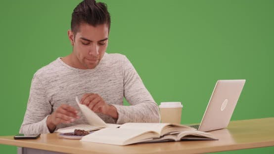 Thumbnail for Millennial Latino university student in dorm working on laptop on green screen