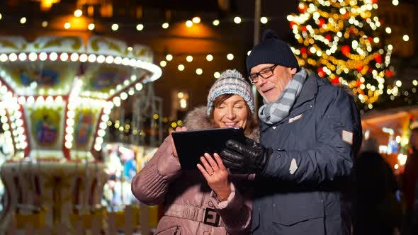 Thumbnail for Senior Couple with Tablet Pc at Christmas Market