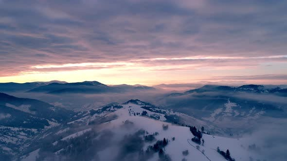 Aerial View in Foggy Sunset Winter Mountain