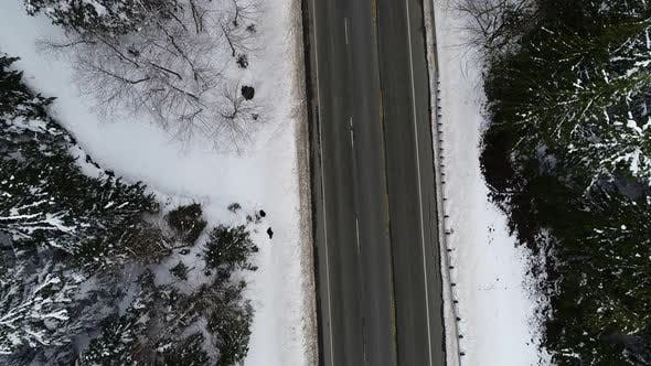 Vehicles Driving Mountain Highway Snow Top Down Aerial View