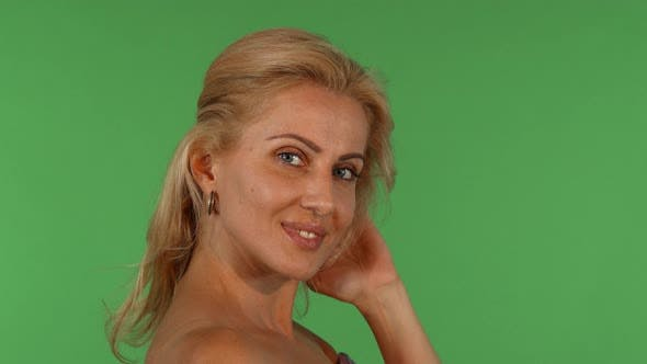 Thumbnail for Stunning Beautiful Mature Woman Smiling Playing with Her Hair
