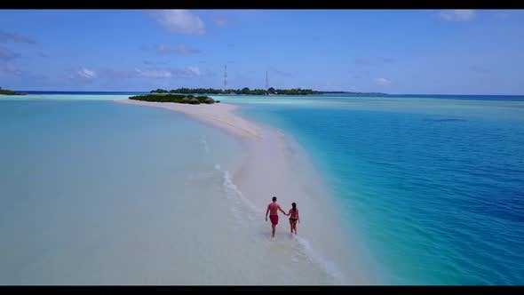 Thumbnail for Guy and girl engaged on tranquil resort beach journey by aqua blue sea with white sand background of