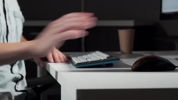 Thumbnail for Cropped Shot of a Man Getting in His Chair in Front of Computer and Starting Work