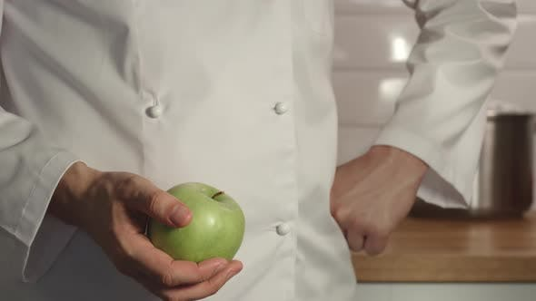 Thumbnail for Chief Throws Up A Green Apple In A Hand
