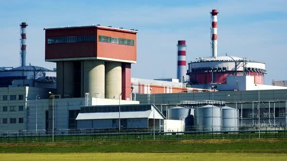 Thumbnail for Factory (Nuclear Power Station) - Closeup of Buildings and Chimneys - Closeup