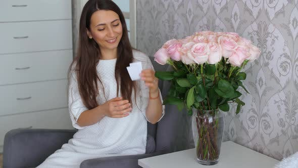 Woman Receive Roses with the Message