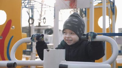 Kid Boy Playing in a Street Gym