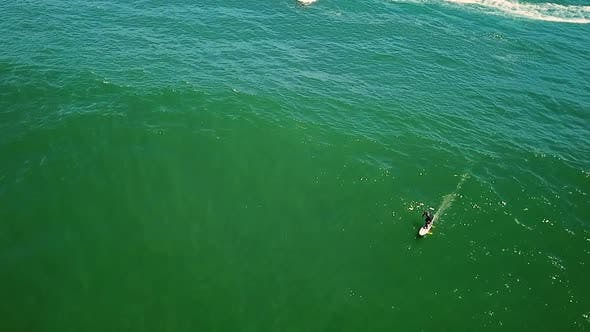 Aerial view of a man surfing near Cape Town, South Africa.