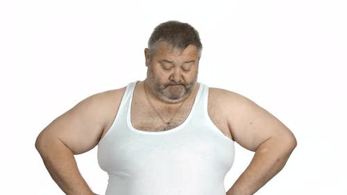 Obese Man with Big Belly Holding Measuring Tape