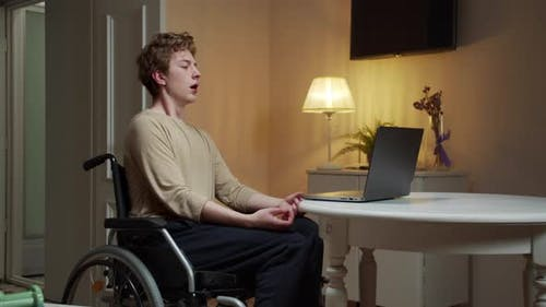 A Disabled Young Man Id Meditating in Silence