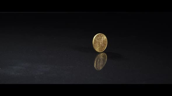 Spinning coin on a reflective surface - MONEY 0048
