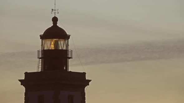 Thumbnail for Lighthouse Lighting in the Twilight at Sunset
