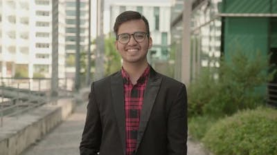 Static Shot of Positive Indian Young Man Smiling
