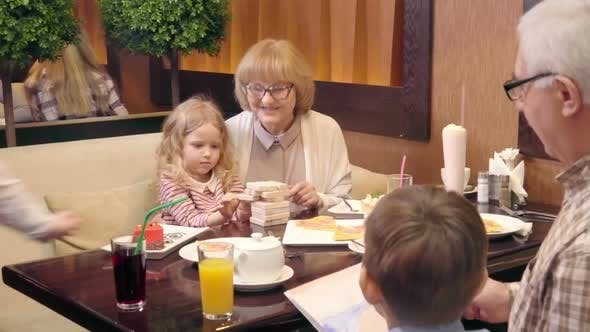 Thumbnail for Grandparents and Kids in Child-Friendly Cafe