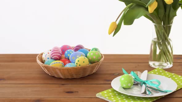 Thumbnail for Easter Eggs in Basket and Flowers on Served Table