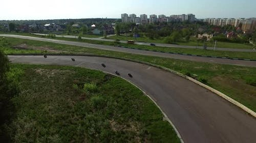 Drone View Motorcyclists Riding on Racing Track. Moto Racing on Speed Track