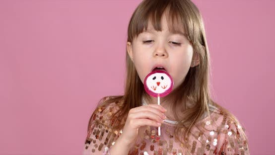 Thumbnail for Young Happy, Smiled, Pretty Little Girl with Sweet Lollypop Candy