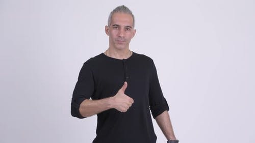 Handsome Persian Man Giving Thumbs Up Against White Background