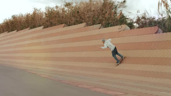 Thumbnail for Skateboarder Doing Dangerous Stall Trick on Street, Skater Man Perform Extreme Big Gap Professional