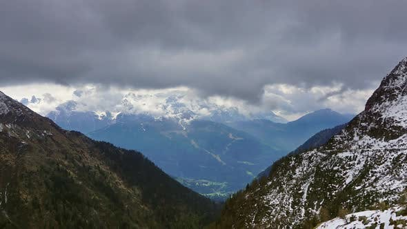 Thumbnail for Snow Mountains in Clouds Landscape in Alps