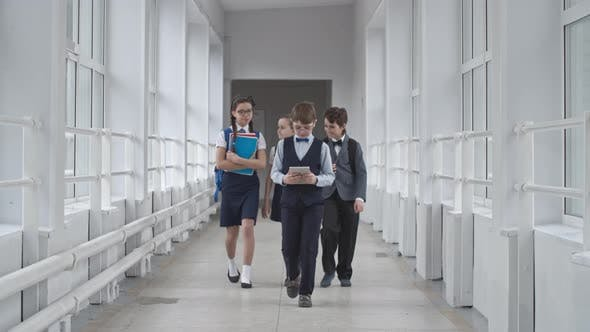 Thumbnail for School Students Walking Along Hallway