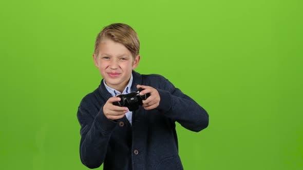 Boy Plays on the Joysticks. Green Screen
