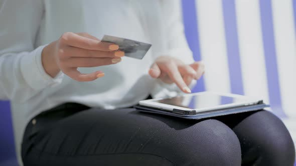 Thumbnail for Girl Holding Credit Card and Using Tablet Pc