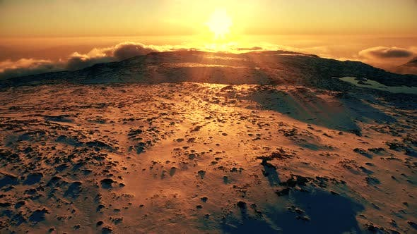 Thumbnail for Mountain and Sun at Sunset in Winter. Aerial View