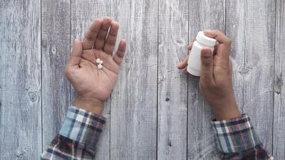 Top View of Medical Pills on Palm of Hand