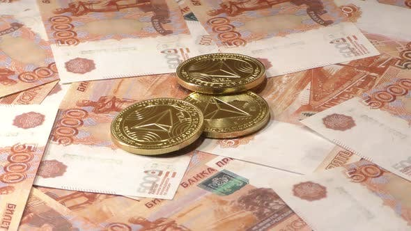Tron TRX Coins Rotating on Bills of 5000 Russian Rubles. Worldwide Virtual Internet Cryptocurrency