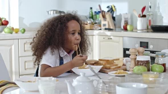 Thumbnail for Little Girl Having Spaghetti for Dinner