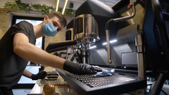 Thumbnail for Concentrated Male Barista in Coronavirus Face Mask Cleaning Coffee Machine in Cafe