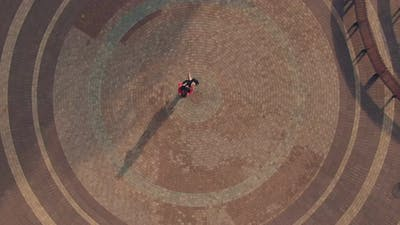 Professional Dancers Dance Tango on a Cobbled Street. Aerial View Video From Copter. Top View.