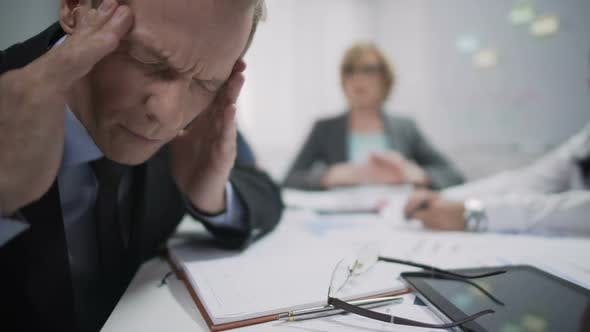 Thumbnail for Male Worker has Migraine Attack Caused by Stress and Exhaustion at Workplace