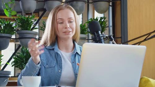 Cute Woman Telling Some Information for Listeners on Radio