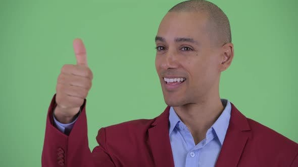 Thumbnail for Face of Happy Bald Multi Ethnic Businessman Giving Thumbs Up