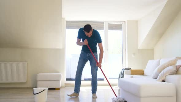Thumbnail for Man with Mop Cleaning Floor at Home 39