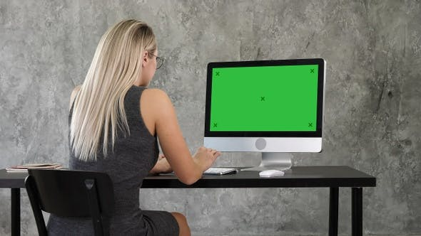 Thumbnail for Businesswoman using desktop computer in creative office.