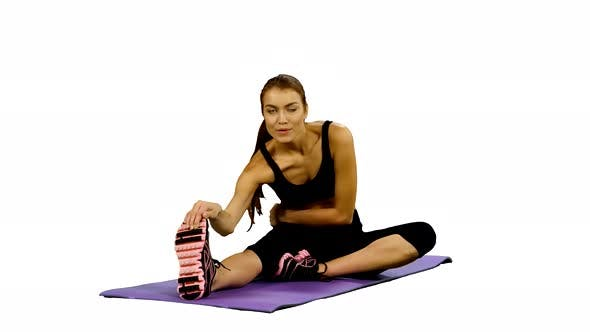 Thumbnail for Frau praktiziert Yoga im Fitnessstudio, Stretching. Weißer Hintergrund