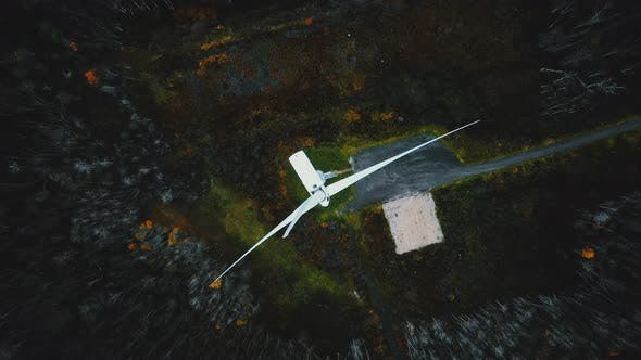 Thumbnail for Top View Drone Rotating Directly Above Working Windmill Turbine in Green Forest, Concept of Future