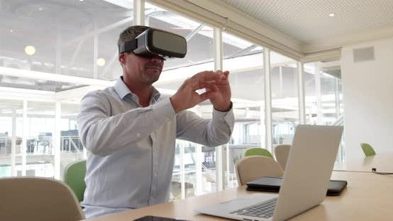 Businessman using virtual reality headset at desk in modern office 4 4k