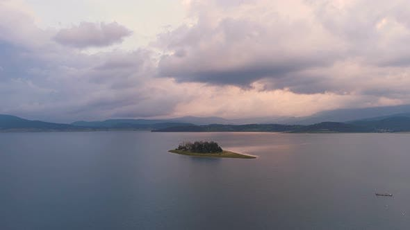 Thumbnail for Amazing Drone View of Sunset Over Lake Island with Vibrant Clouds