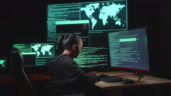 Asian Young Girl Hacker Hacking With Multiple Computer Screens In Dark Room